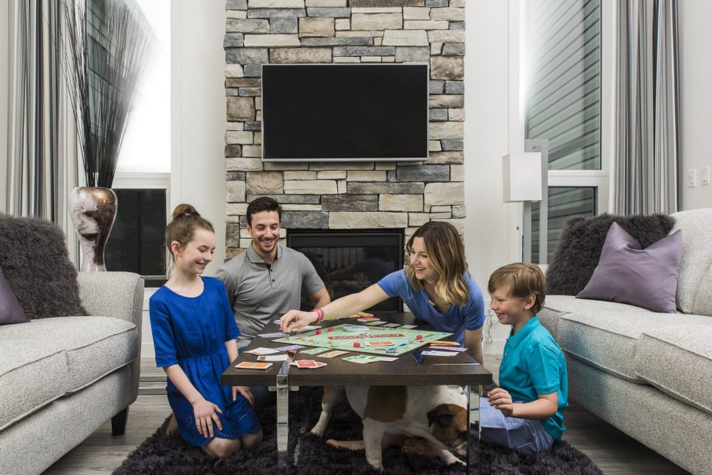 family playing board games in the living room