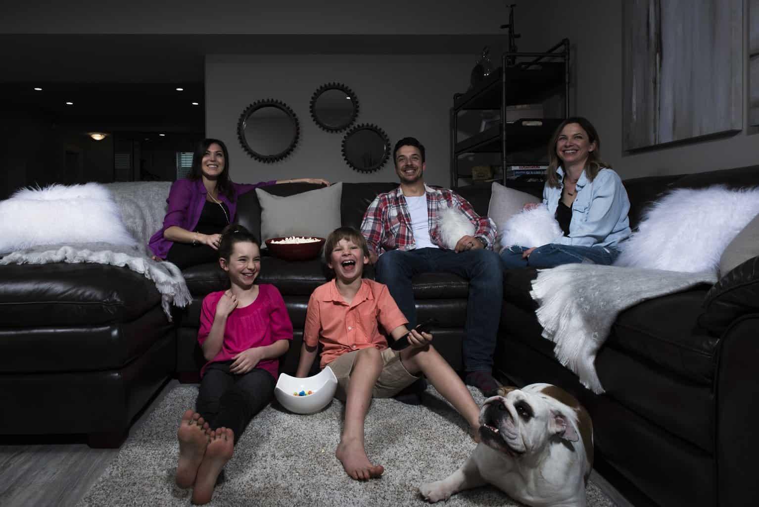 family enjoying a movie night