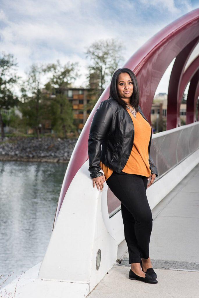 nice portrait of woman leaning on a bridge