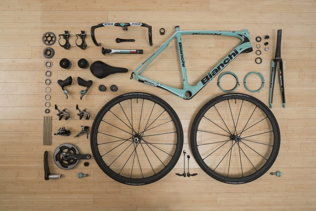 bicycle taken apart and laying down on the floor