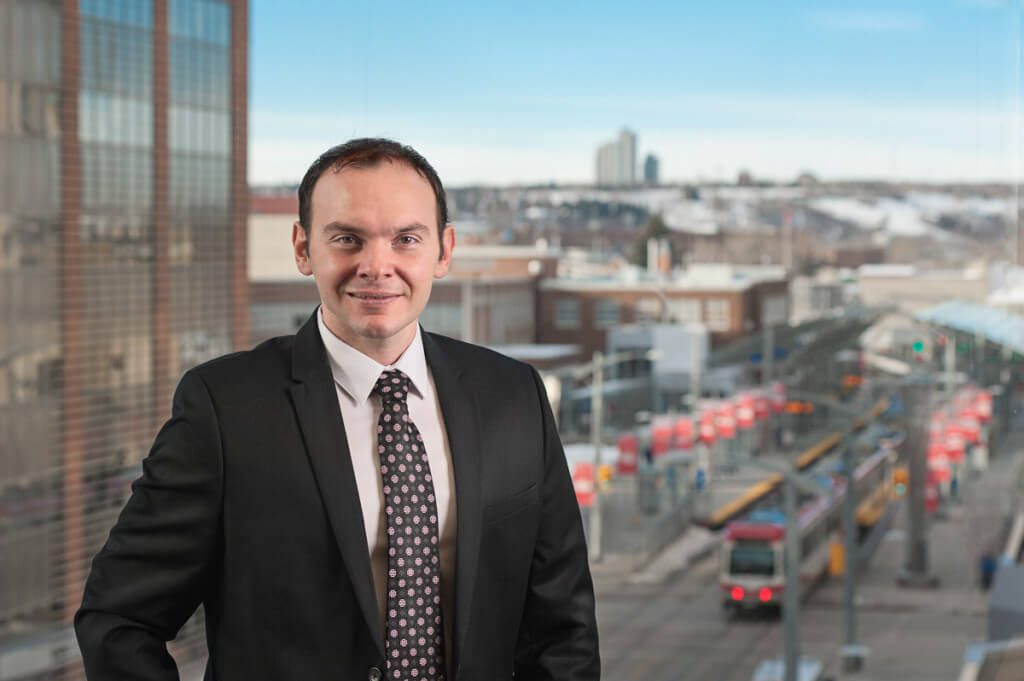 colorful portrait of an executive with the train in the background