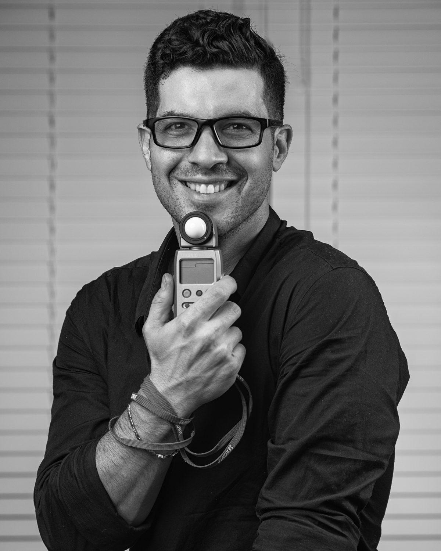 photographer holding a lightmeter