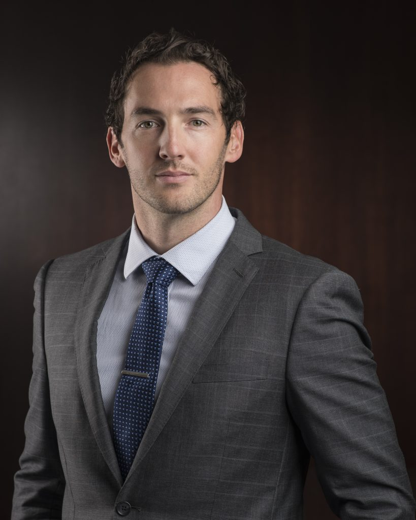 executive in a suit posing for a professional headshot