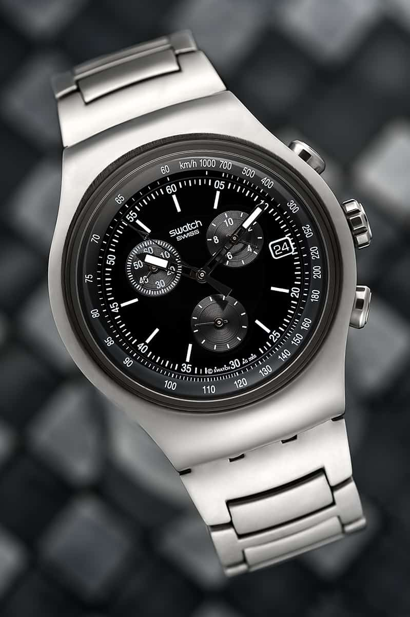 nice lit product image of a swatch watch on a blurry background