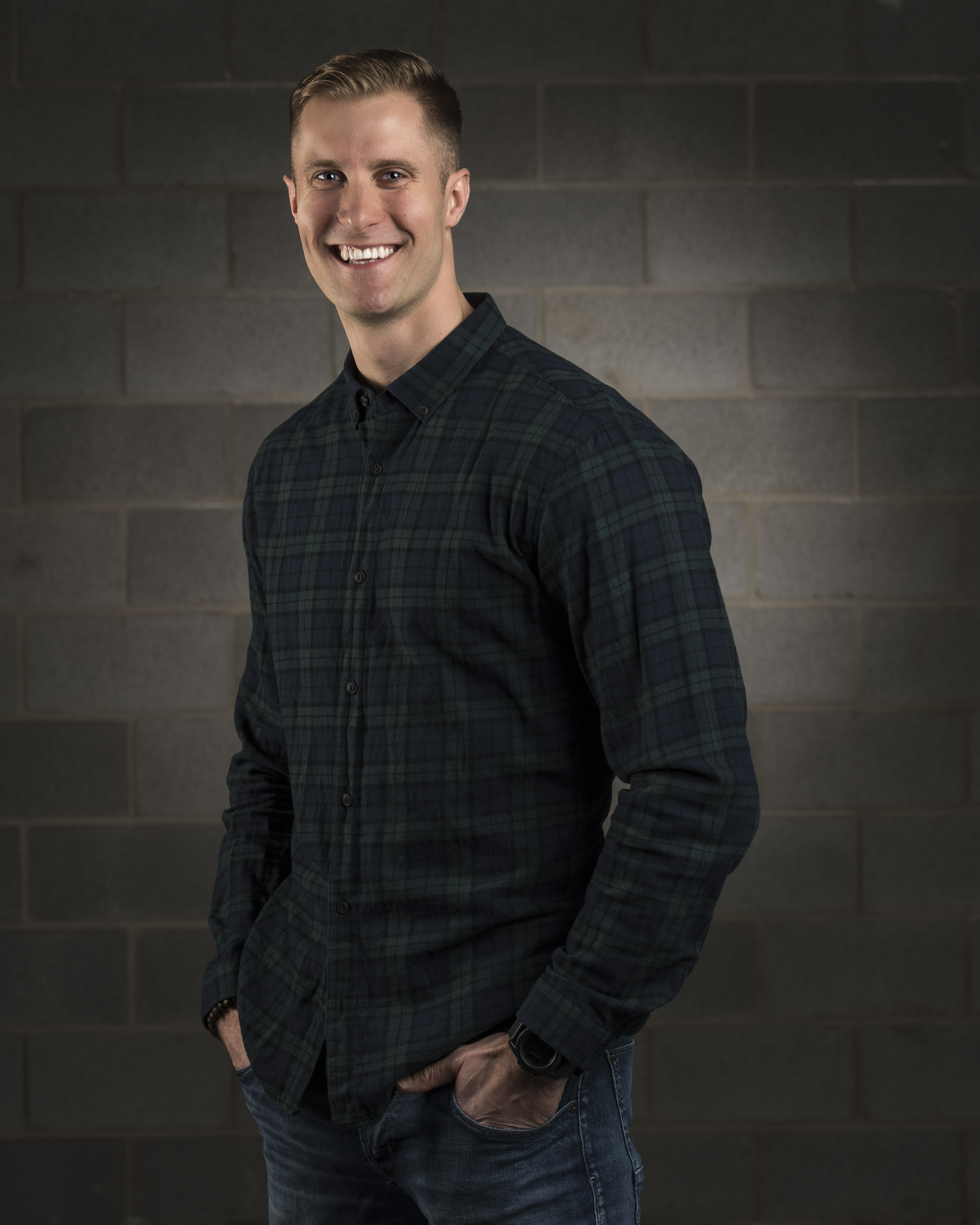tall blond guy smiling with his hands on the pockets
