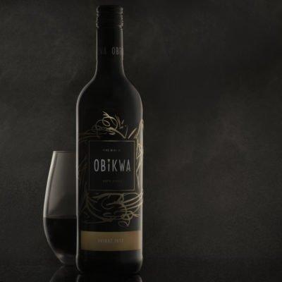 wine bottle on a misty black background