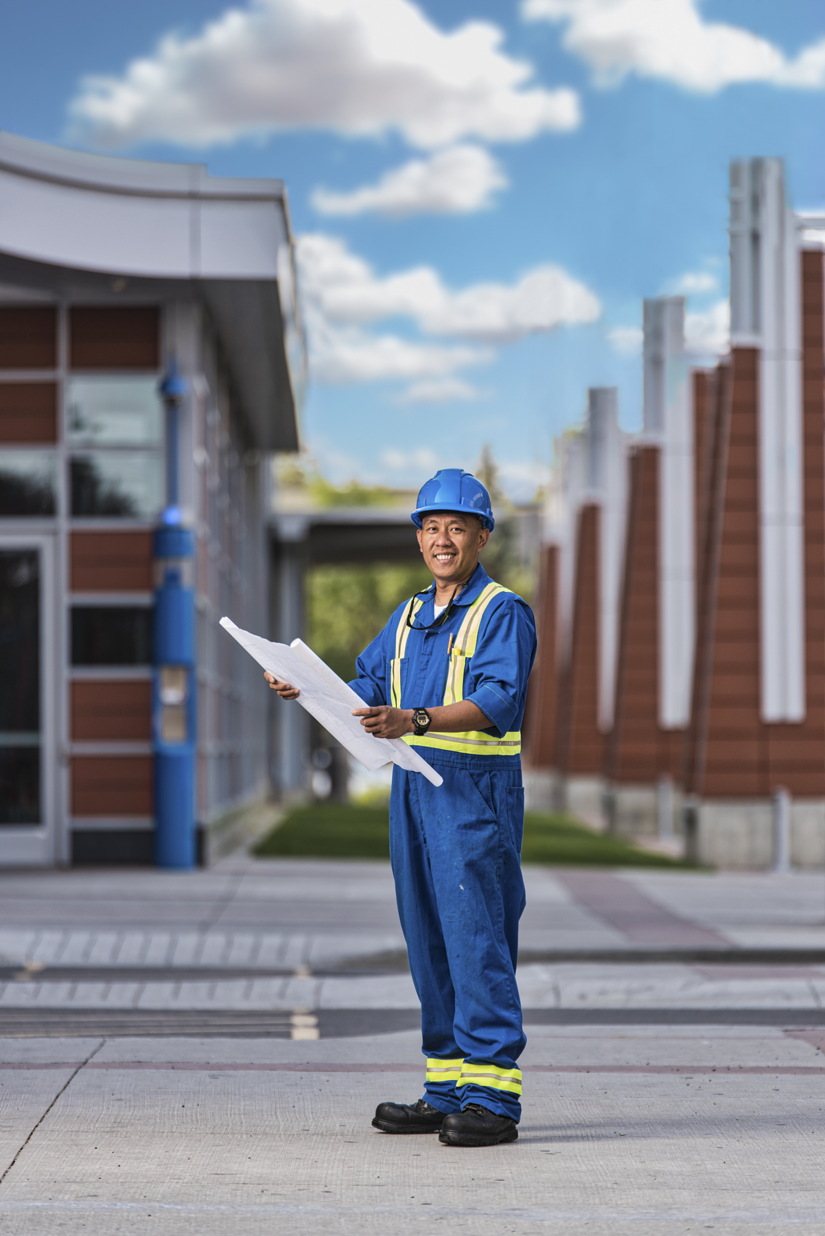 editorial photo of an architect holding a blue print